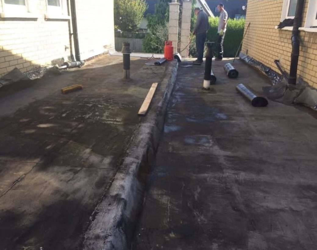 https://southdublinflatroofing.com/wp-content/uploads/2020/03/Flat-Roof-Maintenance-and-Repairs-Dublin.jpg
